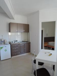 A kitchen or kitchenette at Fantasia Hotel Apartments