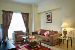 A seating area at Village Residence Hougang by Far East Hospitality