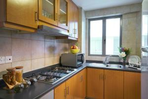 A kitchen or kitchenette at Village Residence Hougang by Far East Hospitality