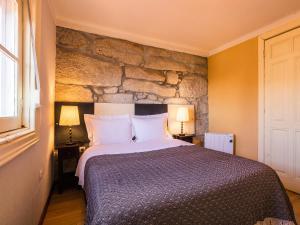 Uma cama ou camas num quarto em Pedra Iberica
