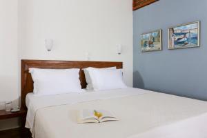 Ένα ή περισσότερα κρεβάτια σε δωμάτιο στο 9 Μούσες