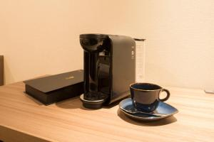 Coffee and tea-making facilities at Tokyu Stay Ginza