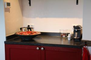 Een keuken of kitchenette bij Gastenverblijf Kleinkamperfoelie