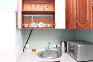 Кухня или мини-кухня в PiterFlat - Апартаменты на Гороховой 30