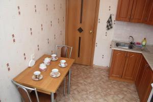 Кухня или мини-кухня в PiterFlat - Апартаменты на Лиговском 105