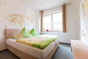 A bed or beds in a room at Hostel Jena