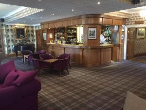 The lobby or reception area at The Royal George Hotel