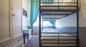 A bunk bed or bunk beds in a room at Casa Bertini