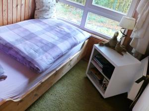 A bed or beds in a room at Holiday Home Ferienpark Extertal