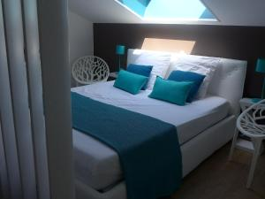 A bed or beds in a room at Apartment Les Berges Landaises-1