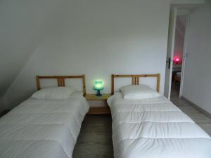 A bed or beds in a room at Holiday Home Rosnual