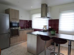 A kitchen or kitchenette at Holiday Home Rosnual
