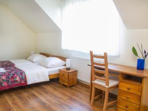 A bed or beds in a room at Holiday Home Balice