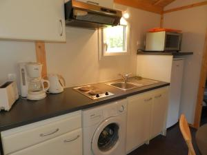 A kitchen or kitchenette at Holiday Home Gîtes Fialoux