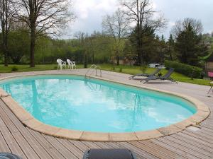 The swimming pool at or near Holiday Home La Colinoise
