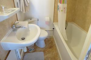 Ein Badezimmer in der Unterkunft Hôtel Victoria