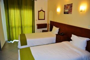 A bed or beds in a room at Residencial A Doca