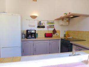 A kitchen or kitchenette at Holiday Home la Villa des Néréides