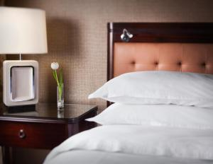 A bed or beds in a room at Sheraton Suites Chicago O'Hare