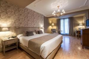 Кровать или кровати в номере Vincci Lys