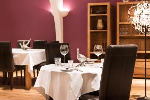 Ein Restaurant oder anderes Speiselokal in der Unterkunft Parkhotel Langenthal
