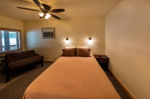 A bed or beds in a room at Halfway Hotel