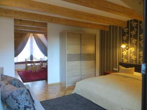 Łóżko lub łóżka w pokoju w obiekcie Residenz Polenia