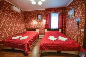 A bed or beds in a room at Briz Hotel