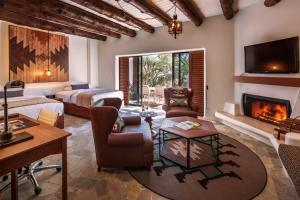 A seating area at Boulders Resort & Spa Scottsdale, Curio Collection by Hilton