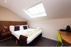 A bed or beds in a room at The Place