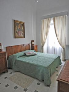 A bed or beds in a room at Il Palazzo