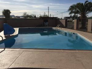 The swimming pool at or near Amazon Motel