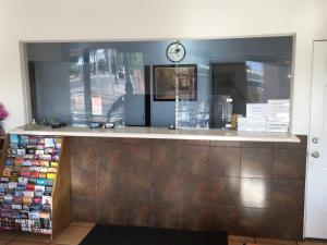 The lobby or reception area at Amazon Motel