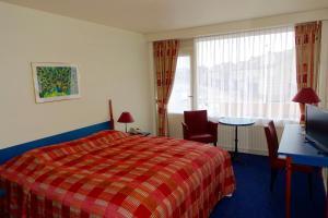 Een bed of bedden in een kamer bij Hotel Prins Maurits