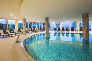 The swimming pool at or near Spa & Wellness Hotel Pinia