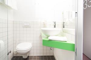 A bathroom at 7 Days Premium Hotel Salzburg-Urstein