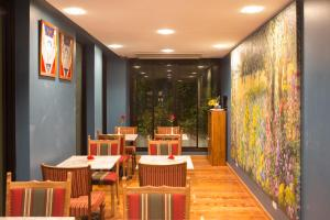 A restaurant or other place to eat at Nine Design Place