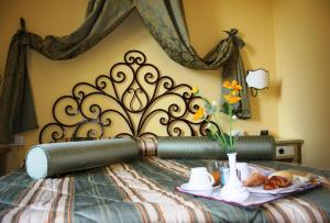 A bed or beds in a room at Relais Cappuccina