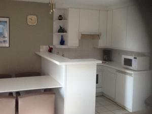 A kitchen or kitchenette at Morgenzon Apartment