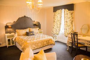 A bed or beds in a room at Aylestone Court Hotel