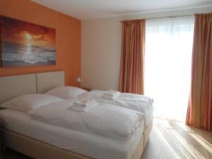 Ein Bett oder Betten in einem Zimmer der Unterkunft Seehotel Lönö