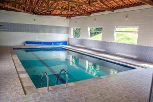 A piscina localizada em Hotel Fazenda Monte Sião ou nos arredores