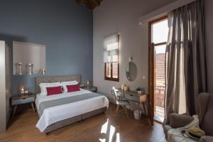 A bed or beds in a room at Bluebell Luxury Suites