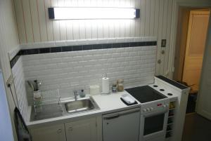 A kitchen or kitchenette at Appartement Cosy et Très Parisien
