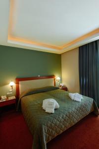 Cama o camas de una habitación en Athens Mirabello