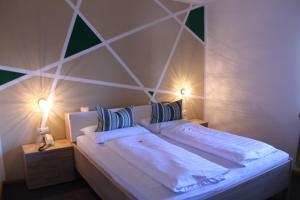 Letto o letti in una camera di Garni Brunnenhof