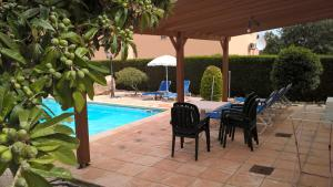 The swimming pool at or near Kapsalia Holiday Villas