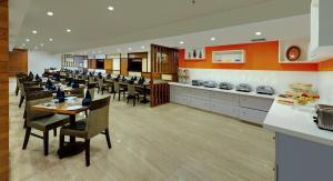 A restaurant or other place to eat at Best Western Alkapuri