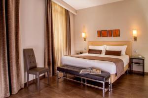 Een bed of bedden in een kamer bij Basilio 55 Rome