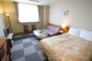 A bed or beds in a room at Ishiuchi Yung Parunas